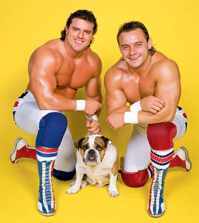 The british bulldogs posing in tights and laced up boots with Matilda their British Bulldog Animal Mascot