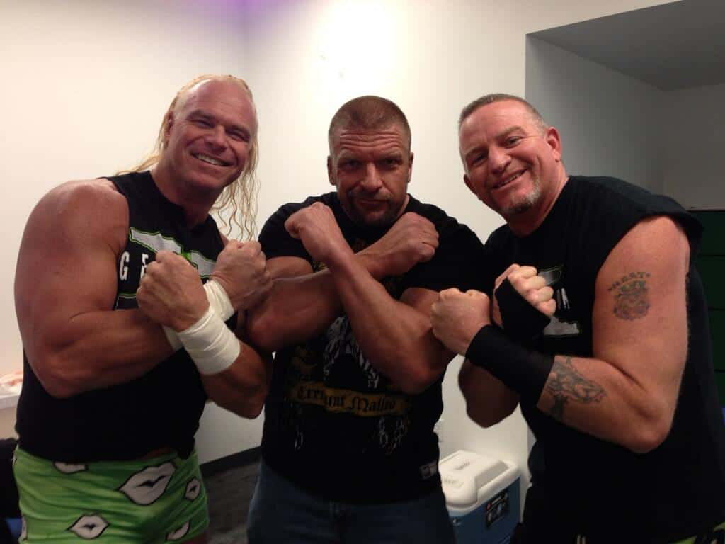 The New Age Outlaws, Billy Gunn and Road Dogg with their Kliq 'friend', Triple H
