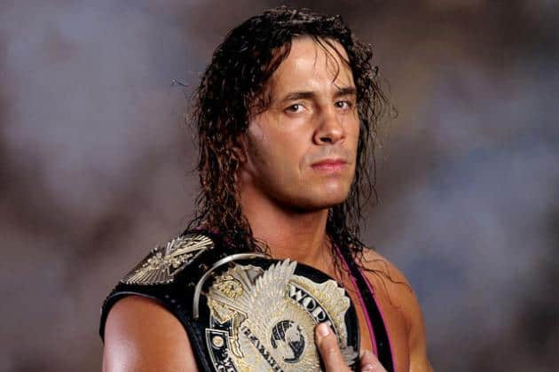 Headshot of Bret Hart with a title belt for our 9 Best Bret Bart Moments