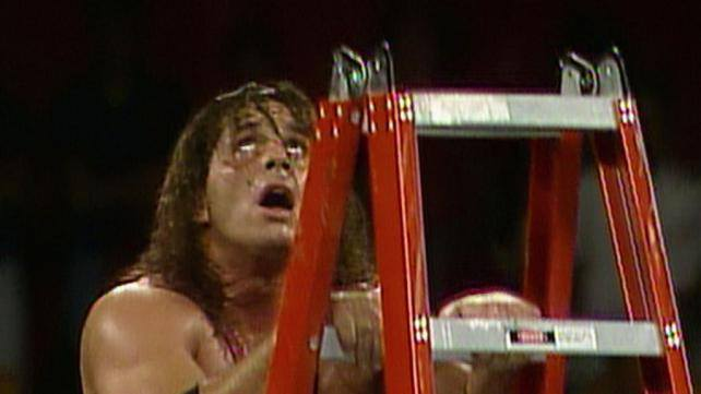 Bret Hart climbing a red ladder