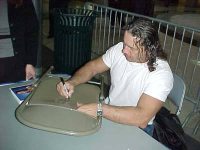 Bret Hart autographing a metal chair