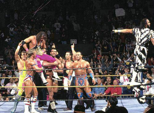 Bret Hart lifted up on the shoulders of other wrestlers in the ring
