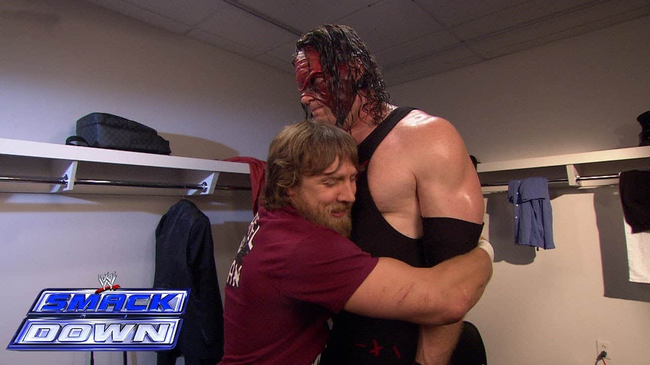 Daniel Bryant hugging Kane in the locker room at Smackdown