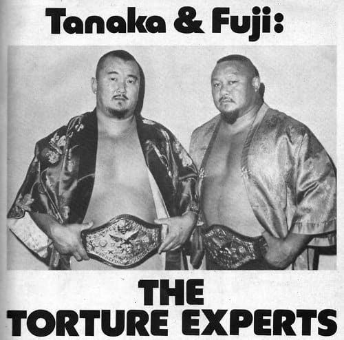 Mr. Fuji and Tanaka in posing with title belts in oriental robes