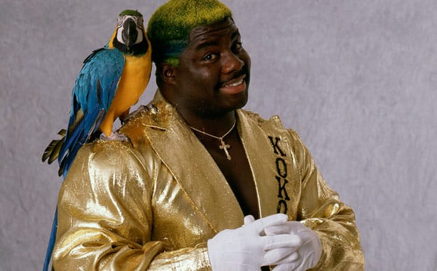 Koko B Ware in a gold jacket with his wrestling animal Frankie the bird on his shoulder