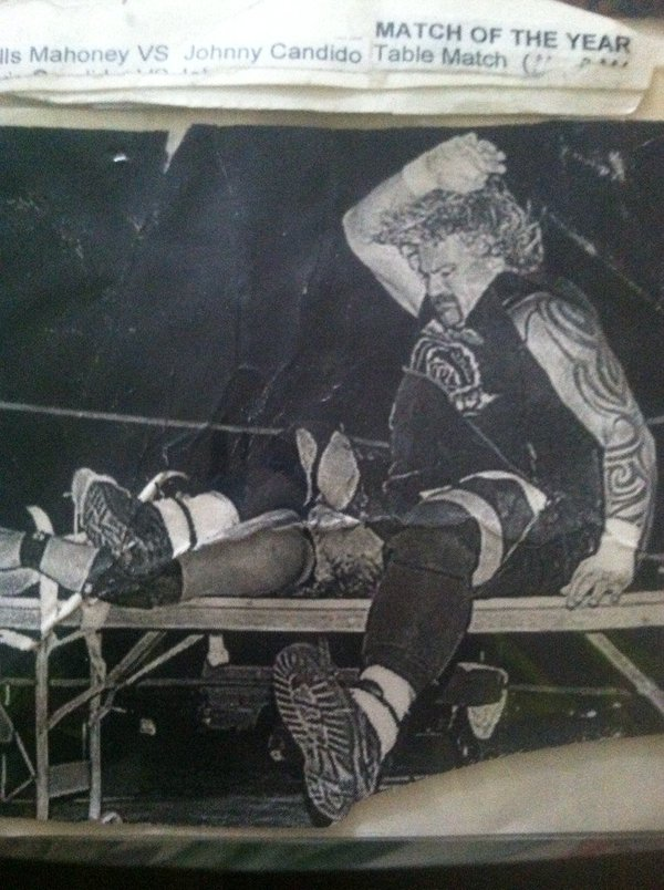 Balls Mahoney crushing Jonny Candido's face on the world's stiffest table after Balls duct-taped Johnny Candido to it.
