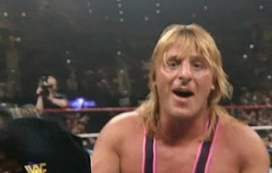 Owen hart smiling and having fun in the ring