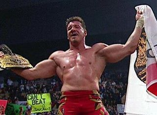 Eddie Guerrero holding up the flag and the title belt