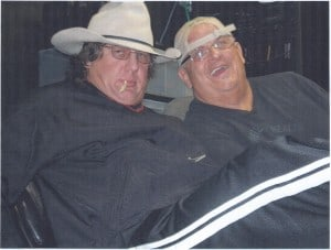 Dr, Tom Pritchard and Dusty Rhodes sitting together in all black with hats on