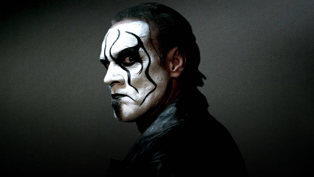 Promo profile headshot of Sting in WWE in full black and white makeup with his hair slicked back
