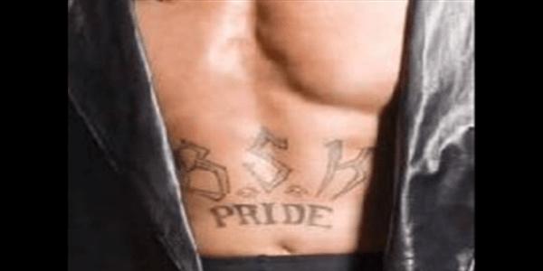Undertaker's 'Bone Street Krew Pride' tattoo on his stomach.