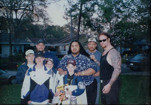 Yokozuna, the Godwinns and Undertaker with 4 young fans back in the '90s