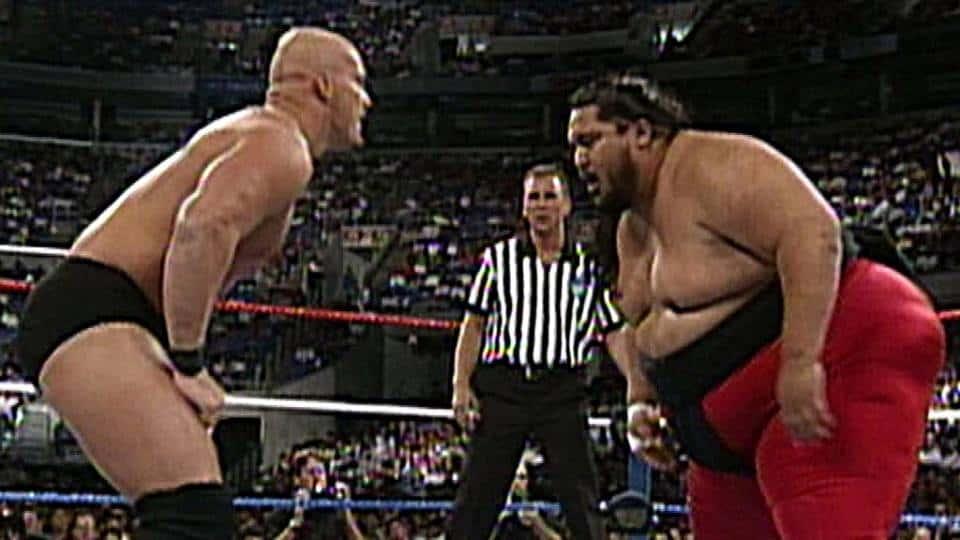 Yokozuna facing off with Steve Austin in the ring