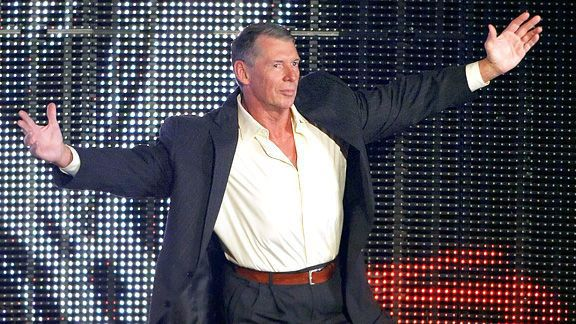 WWE CEO Vince McMahon on Stage with his arms stretched wide