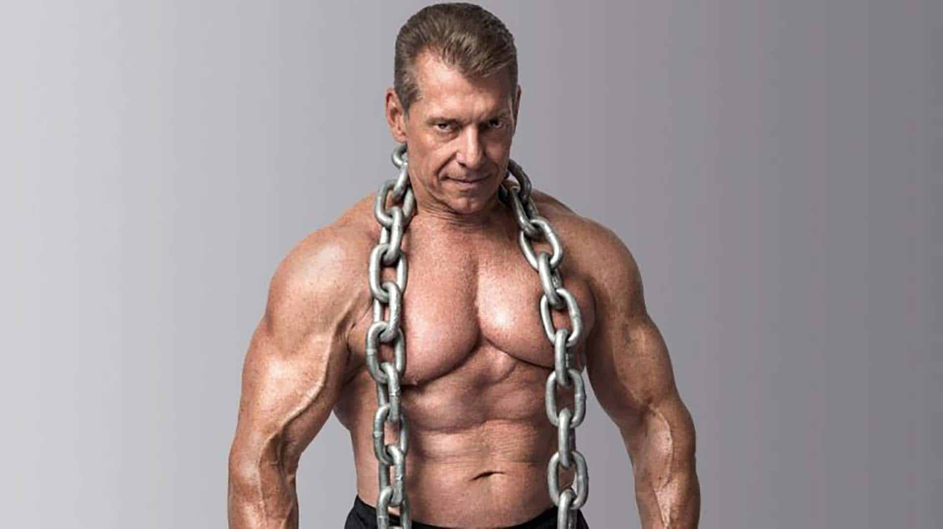WWE CEO Vince McMahon photo for Muscle and Fitness Magazine shirtless with bulging muscles and a big chain hanging around his neck
