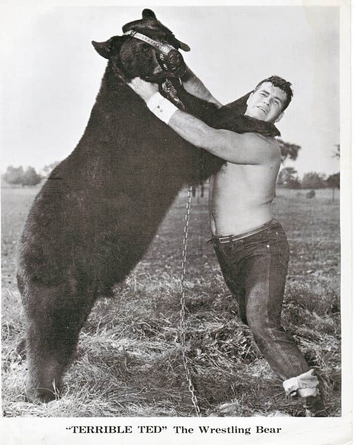 Terrible Ted standing with trainer Dave McKigney, known by the stage name Gene DuBois