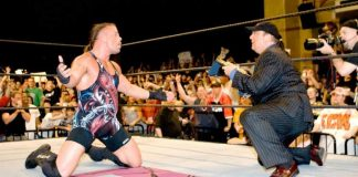 RVD drops down to his knees after defeating John Cena as Paul Heyman awards him the WWE Championship at ECW One Night Stand 2006.