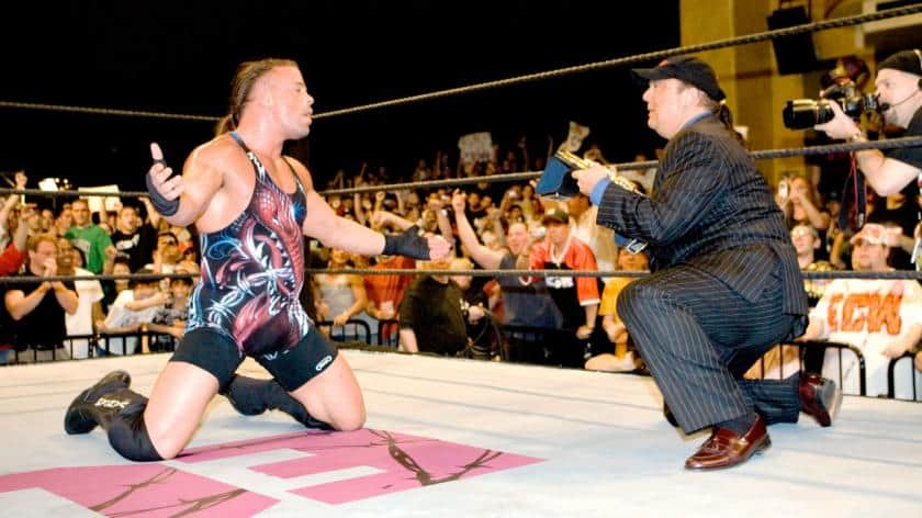 RVD vs John Cena - Rob Van Dam drops to his knees in celebration in the ring as Paul Heyman hands him the WWE Championship after beating John Cena at ECW One Night Stand in 2006