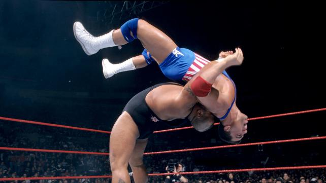 Tazz in the ring flipping Kurt Angle into the air