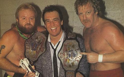 Dennis Condrey with a young Paul Heyman and Randy Rose after defeating Jerry Lawler and Bill Dundee for the titles.