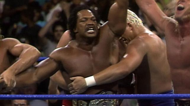 Ron Simmons with his arms up in victory captured the WCW title at a house show in Baltimore, Maryland, in August 1992.