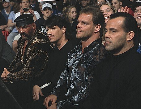 The Radicalz: Perry Saturn, Eddie Guerrero, Chris Benoit and Dean Malenko sitting side by side