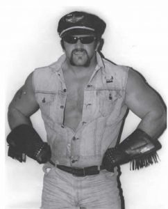 Joe 'Animal' Laurinaitis when he debuted as a single in Georgia as The Road Warrior in late 1982 in a black leather hat and gloves with fringe