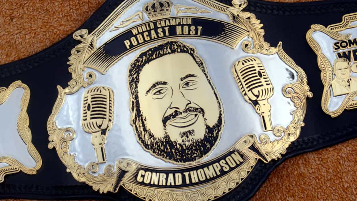 Wrestling Title Belt image World Class Host Conrad Thompson on it and 2 microphones