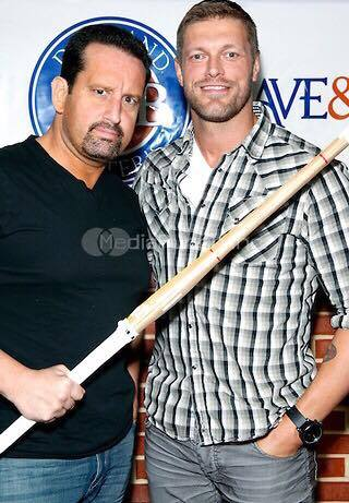 Respect in Wrestling TOMMY DREAMER and EDGE dressed in street clothes. Tommy's holding a piece of bamboo over Edge's chest