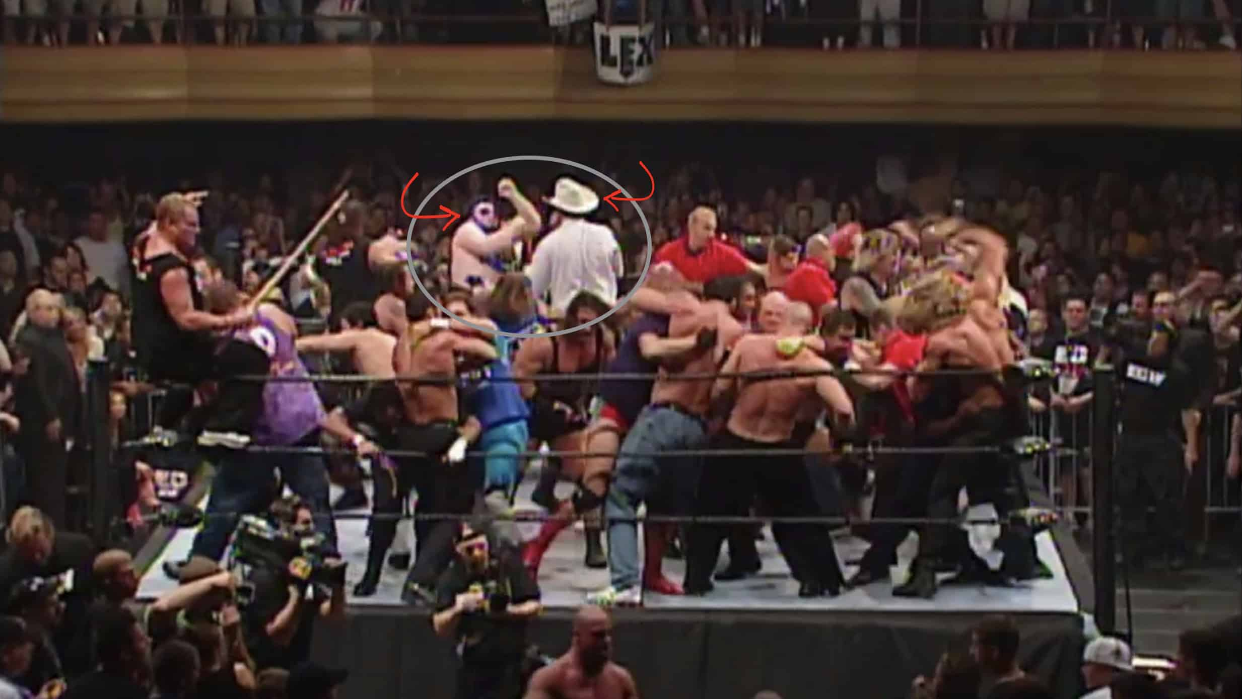 Blue Meanie get's bloodied up by JBL in the ring with a total brawl in the ring