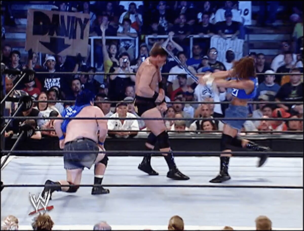 Stevie Richards delivering one of the hardest-to-watch chair shots to JBL's head.