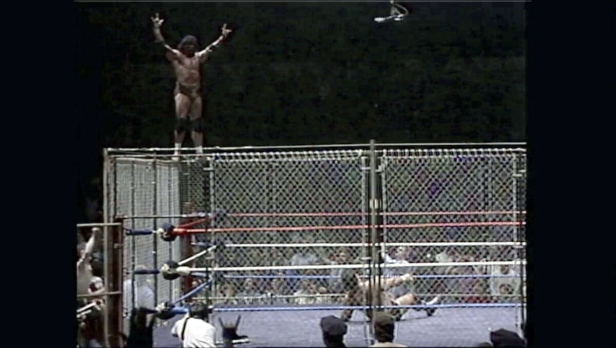 Jimmy 'Superfly' Snuka before leaping off the cage onto 'The Magnificent' Don Muraco during their match at Madison Square Garden