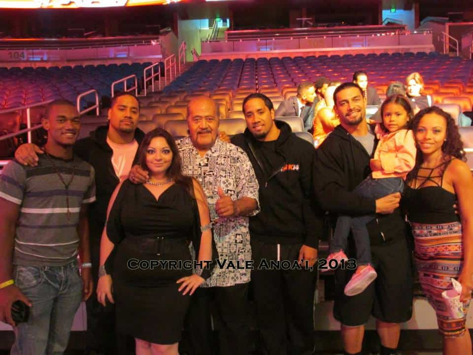 The Anoa'i wrestling family posing in a casual photo together in an empty arena