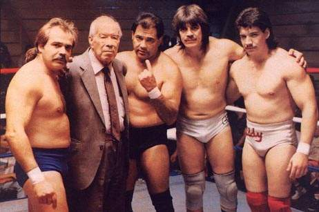 The Guerrero Wrestling family posing in the ring together with one of them holding up one finger to symbolize they are #1