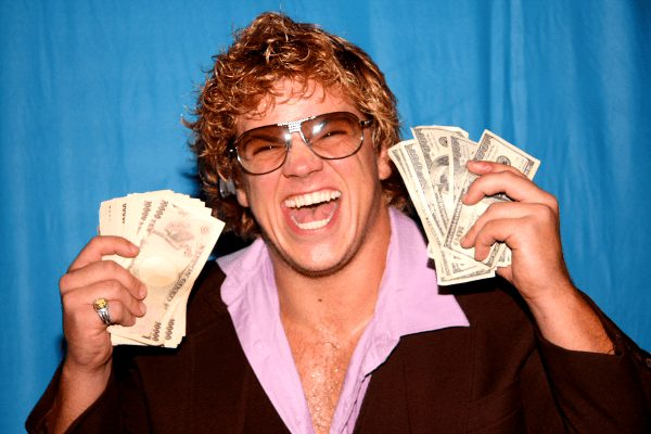 'Sweet and Sour' Larry Sweeney holding up wads of cash and smiling big