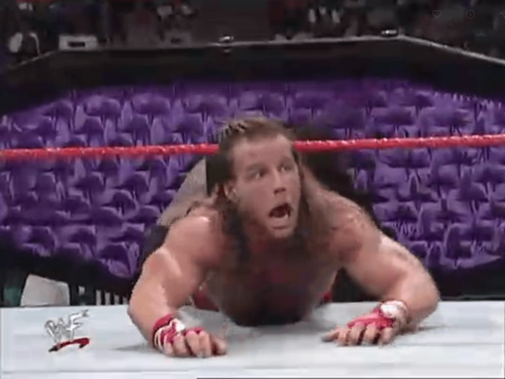 Shawn Michaels attempting to escape the grasp of the Undertaker at 1998's Royal Rumble
