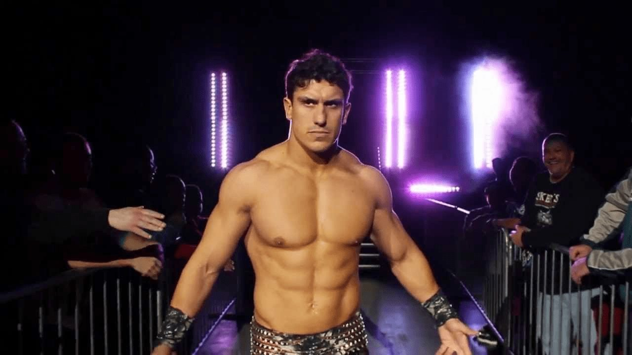 """EC3 entering to his wrestling music, """"Trouble"""" in black leather studded pans and concentration on his face"""