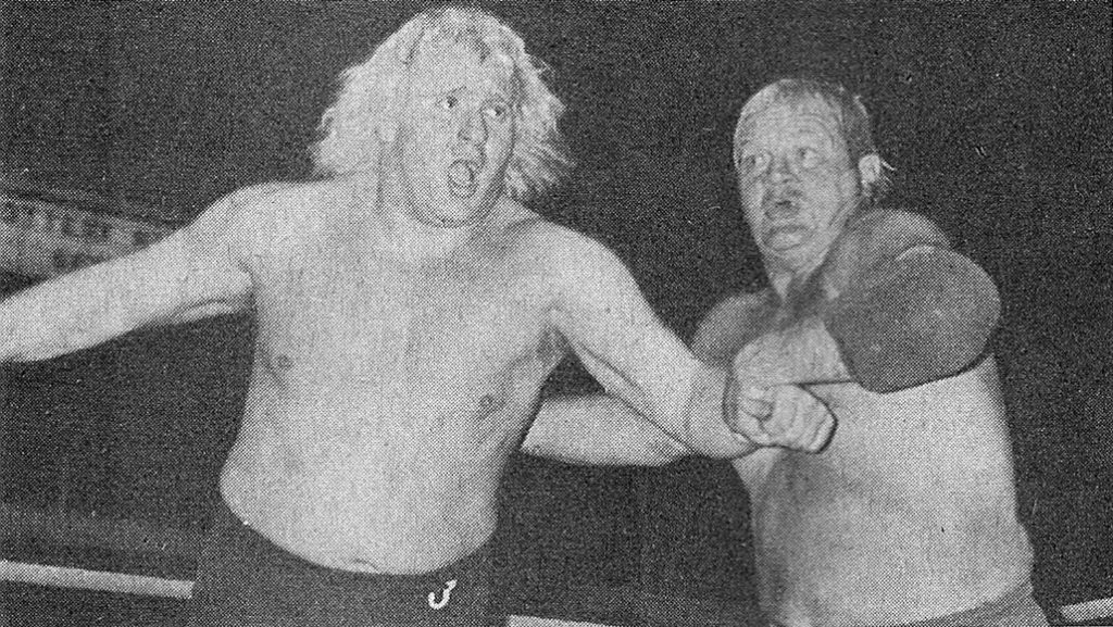 Dick the Bruiser, about to send Johnny Valiant into the ropes, in an unsuccessful bid for the championship belt in 1974.