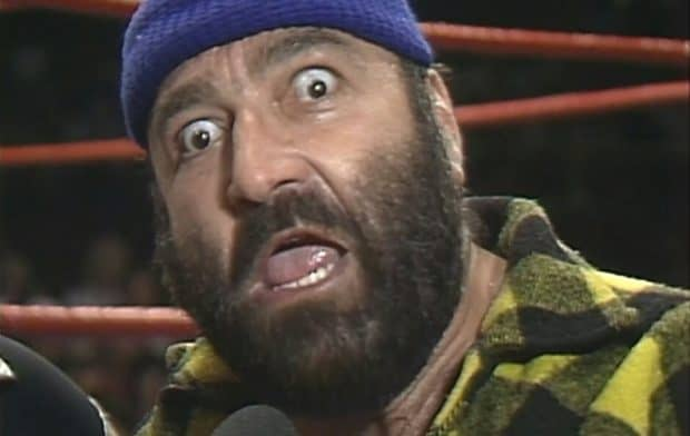 Jos LeDuc, the best heel wrestler, with his eyes wide open yelling into the microphone.