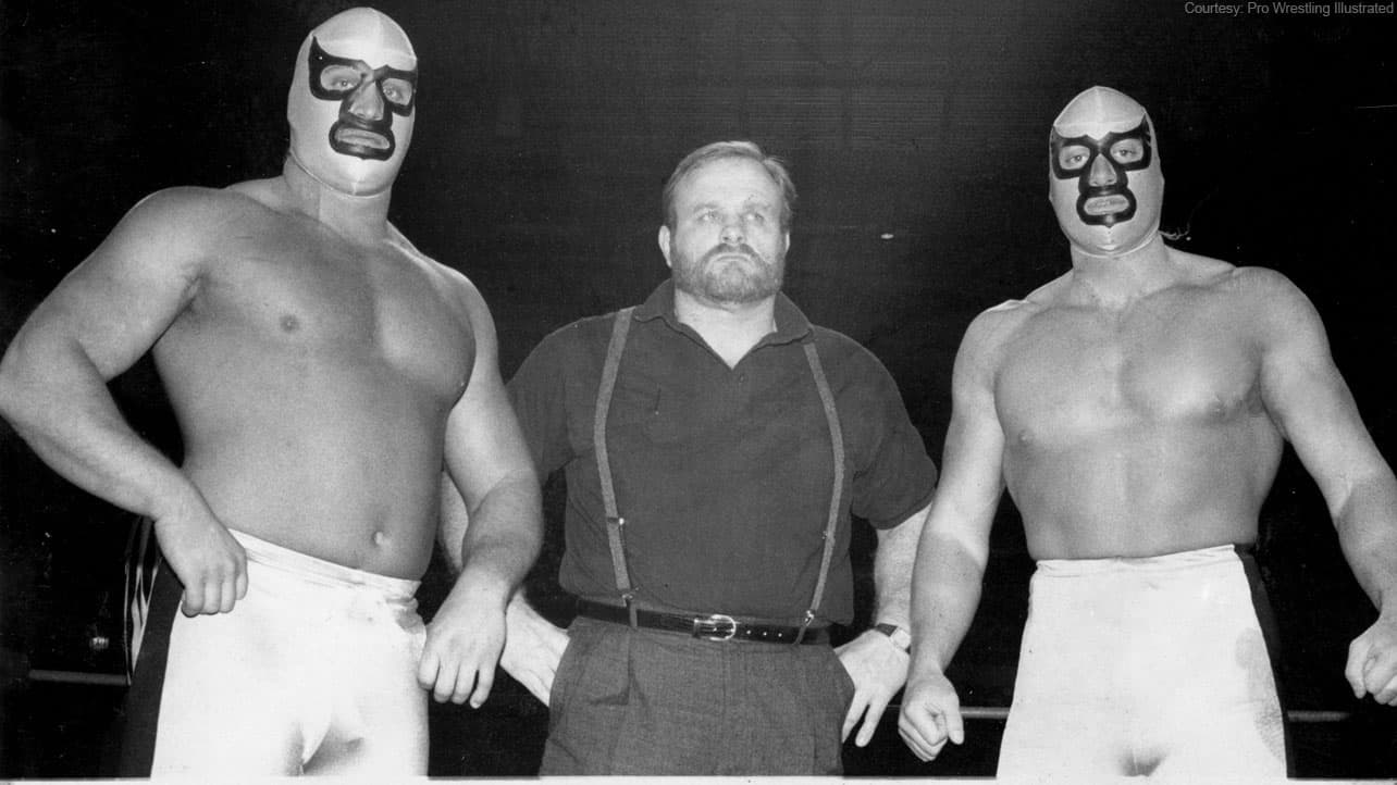 Minnesota Wrecking Crew II (with The Beverly Brothers) standing in the ring ready to rumble