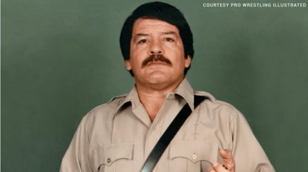Paul Jones in his days as a manager dressed in a khaki military shirt with dark hair and a mustache