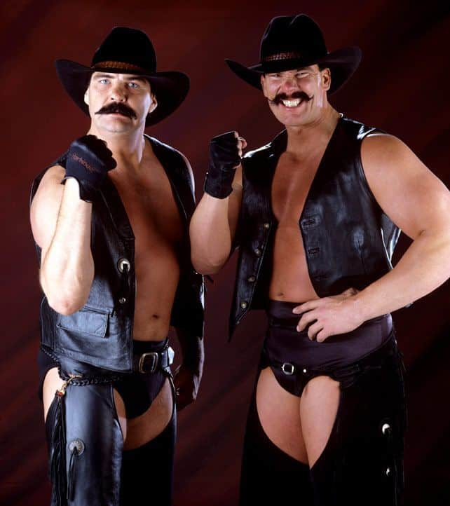 Tag Team The Blackjacks (as the 'New Blackjacks' with Barry Windham and Justin Bradshaw with big 70's mustaches black leather vests and chaps over their wrestling trunks)