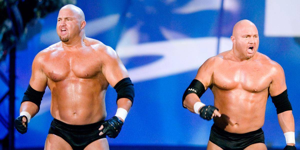 The Gymini, Mike and Todd Shane, in black wrestling trunks on SmackDown as the proteges of Simon Dean in 2006 who learned Do NOT touch Booker T's Red Bulls !