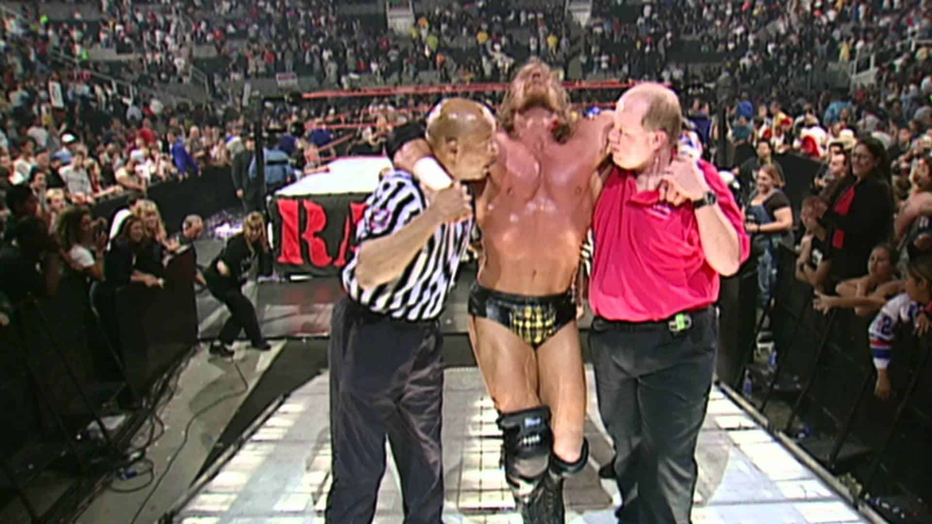 After a Triple H Injury of a Quad Tear to the Left Side he's shown leaning on a referee and trainer exiting the ring in extreme pain