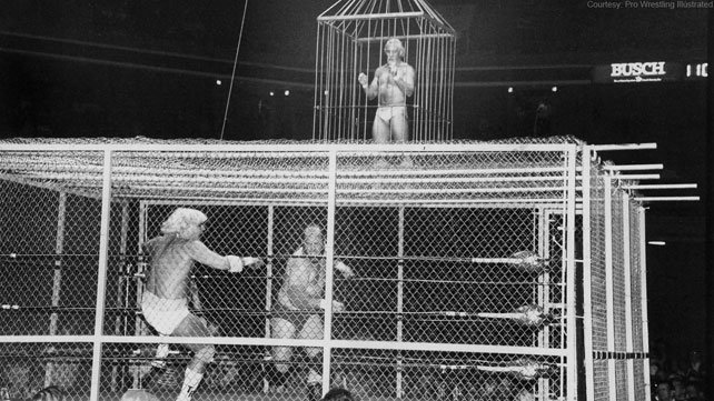 A black and white photo of Tommy Rich, Buzz Sawyer and The Last Battle of Atlanta at the Omni Coliseum, 1983