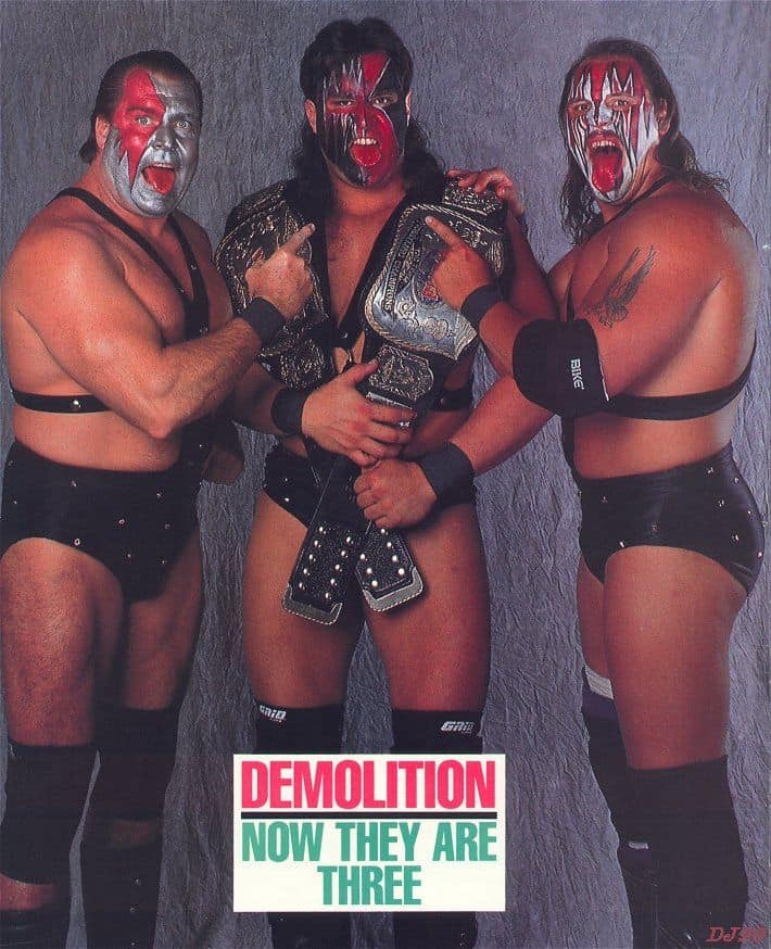 Wrestler Brian Adams as Demolition Crush with the WWF Tag Championship Belts with Ax and Smash