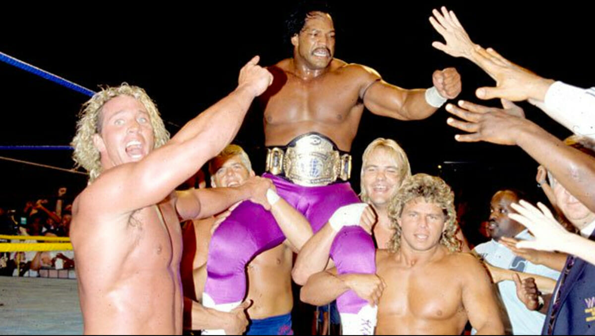 Ron Simmons gets hoisted in the air after winning the WCW World Heavyweight Championship on August 2, 1992.
