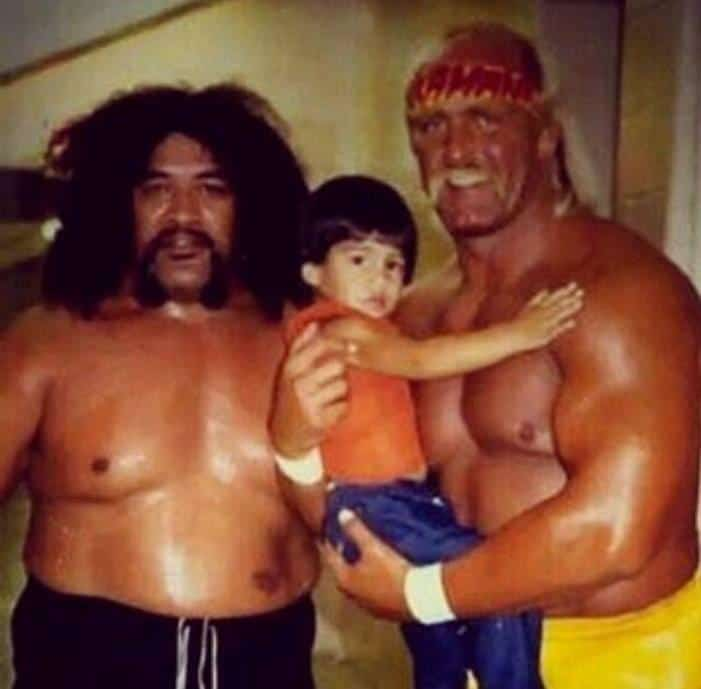 Hulk Hogan and Brutus the Barber Beefcake article: Hulk Hogan pictured with Sika of the Wild Samoans, alongside Sika's son who would grow up to become Roman Reigns