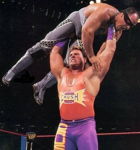 Wrestler Brian Adams holds Repo Man above his head