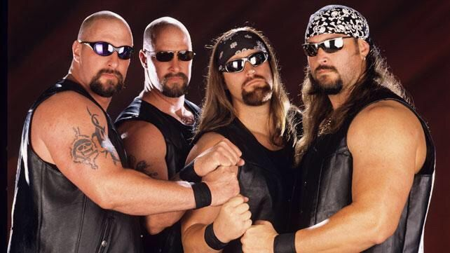 Wrestler Brian Adams Crush alongside his DOA stable members Chainz, Skull and 8-Ball